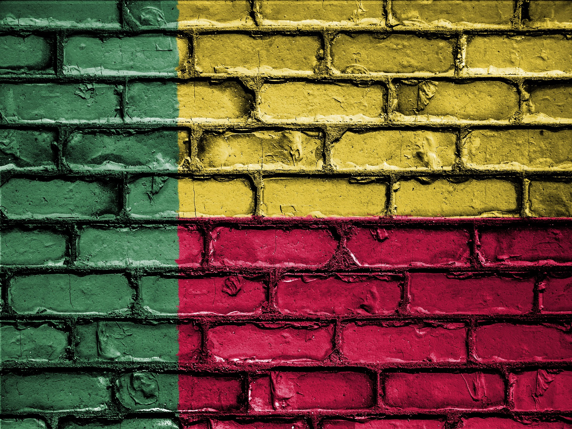 Benin flag painted on brick wall